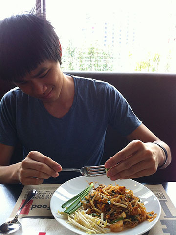 Aaron eating pad thai